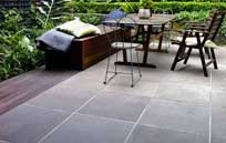 bluestone tiles white grout lines outdoor terrace dining table